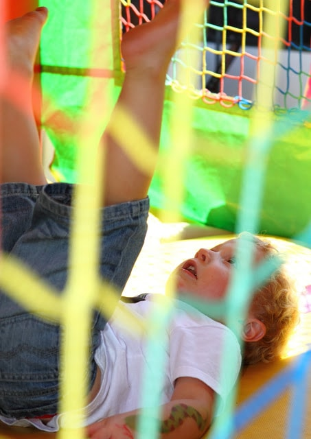a child in a bounce house, falling down