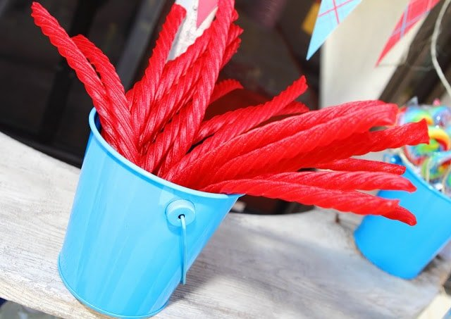 red licorice in a blue bucket