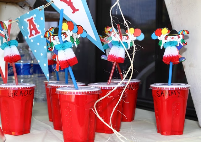 red plastic cups with plastic lids and clown straws
