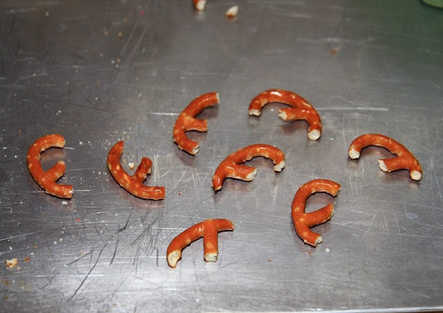 broken pretzels on a baking sheet