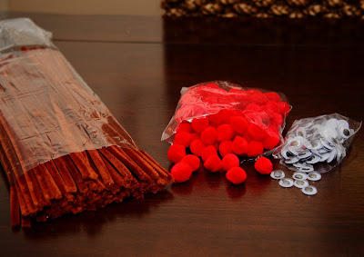 Brown pipe cleaners and red fuzzy balls