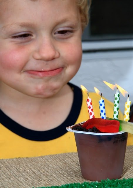 A little boy blowing out birthday candles