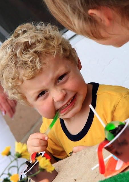 Little boy eating gummy worms