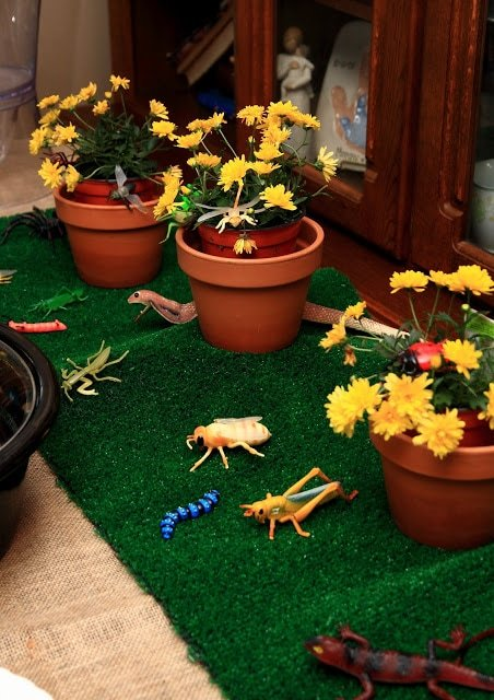 Flowers and bug decor on tables