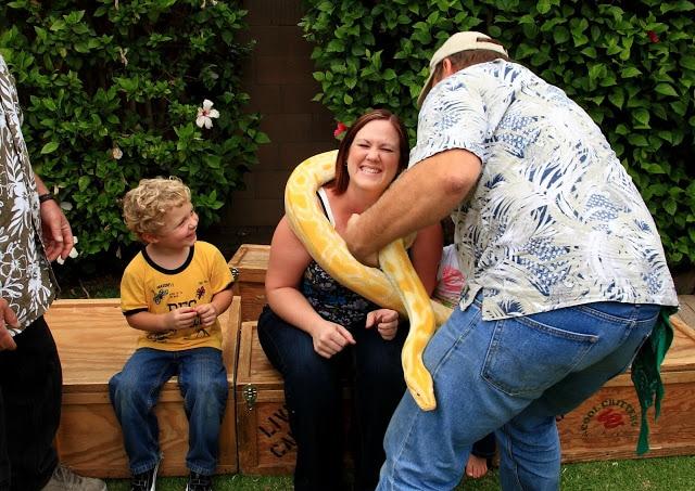 A woman holding an albino boa