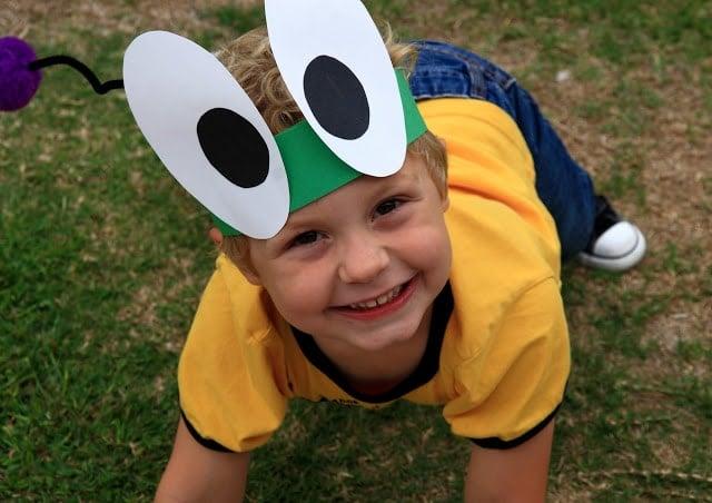 A little boy wearing a bug hat