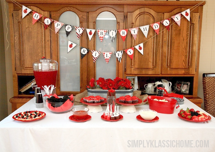 A kitchen with food, punch, and a Happy Birthday sign