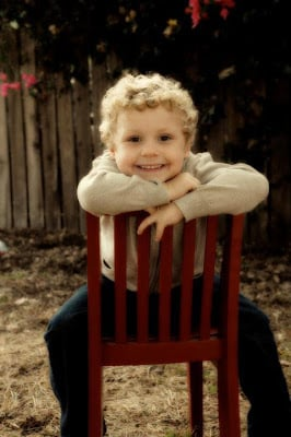 A small child sitting on a chair