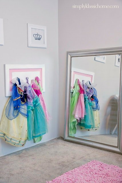 Corner of a room with dresses and a mirror