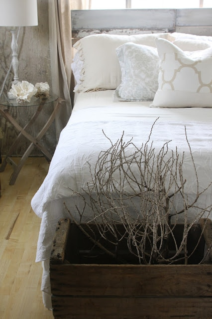 A made white bed in a room