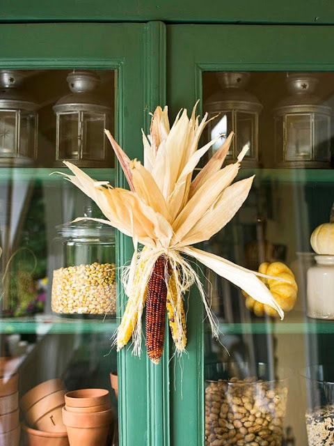 Corn cob swag on a green cupboard