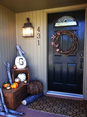 Front porch decorated with fall decor