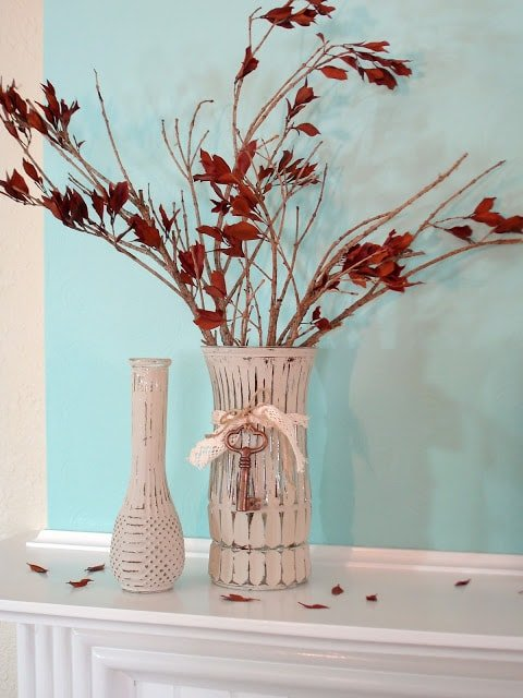 A white vase filled with flowers