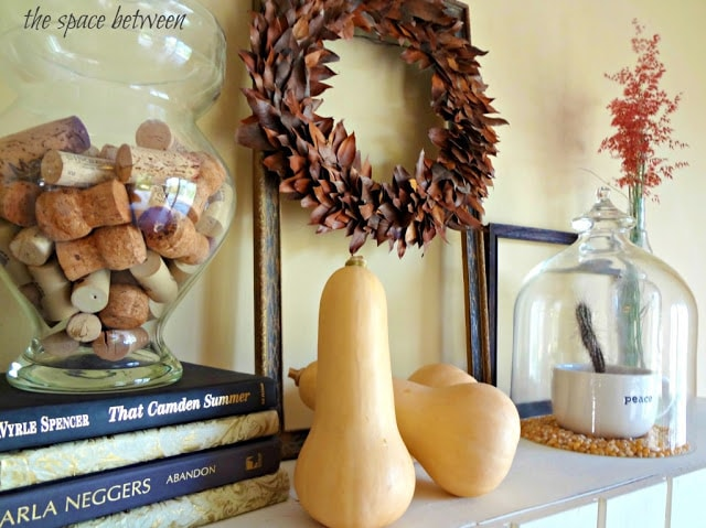 Wreath and squash on a mantel