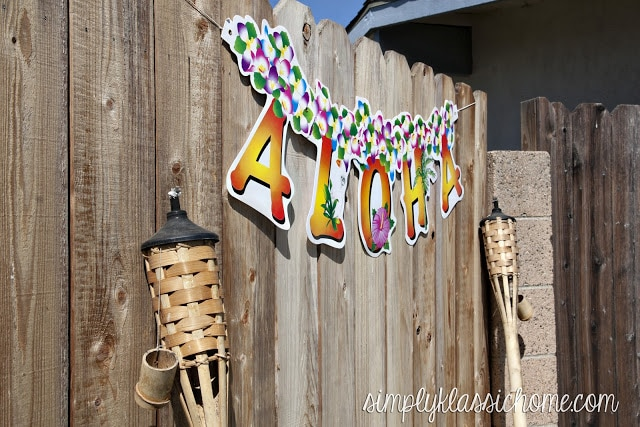 Aloha sign next to tiki torches