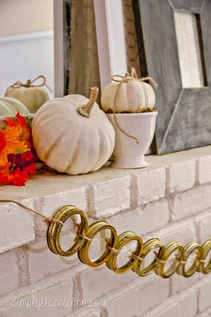 Fireplace mantel decorated for fall