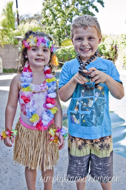 Boy and girl dressed for a luau party