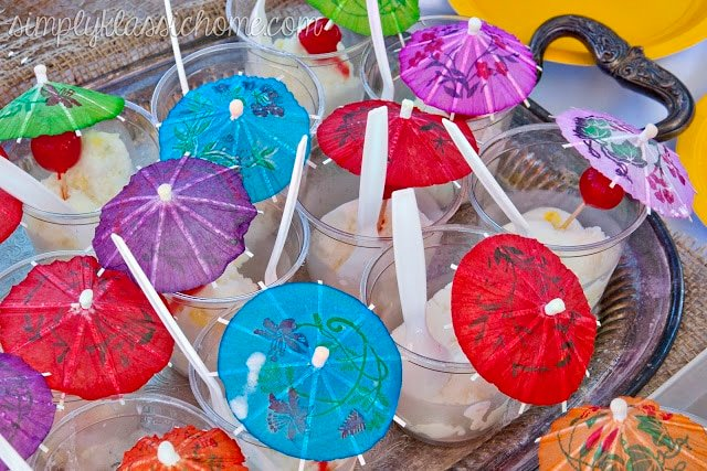 Sherbert with colorful umbrellas on a table