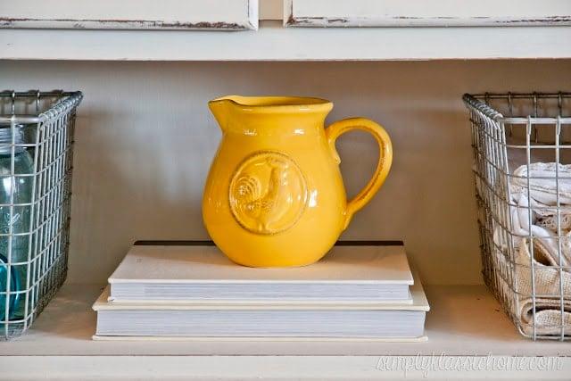 Yellow jug on top of books
