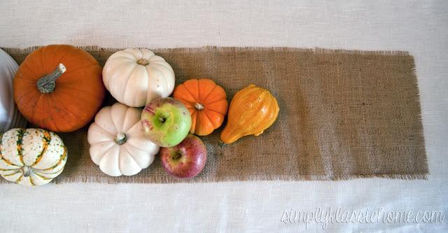 Pumpkins on a burlap runner