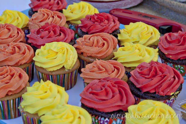 Cupcakes with yellow, orange, and red frosting