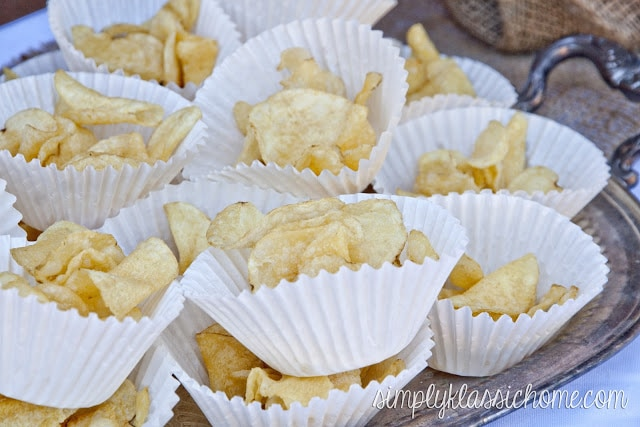 A table full of potato chips in cupcake papers