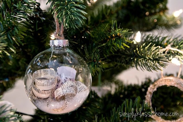 A close up of a glass ornament filled with book paper and epsom salt