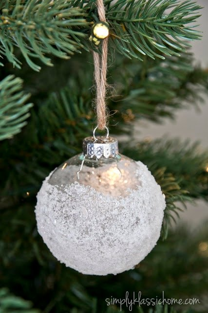 A close up of a glass ornament with epsom salt on the outside