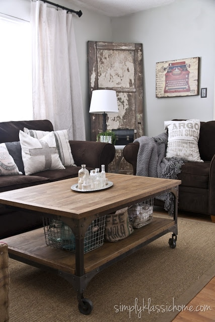 A living room with a wooden coffee table