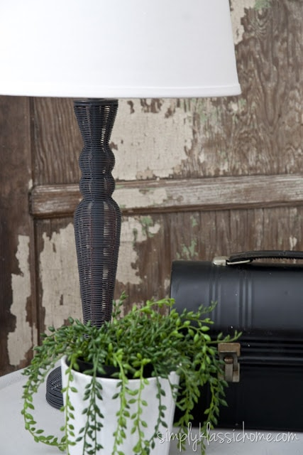 Side table with lamp and plant
