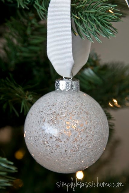 A close up of a white glass ornament