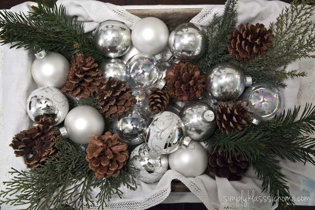 Christmas ornaments and pinecone table centerpiece