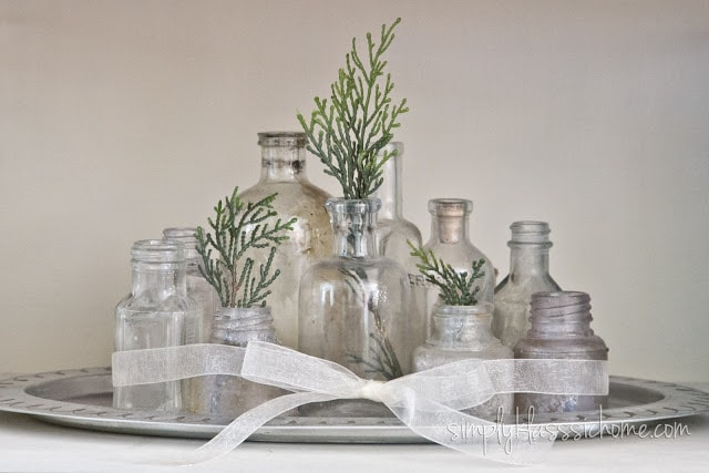 Decorative bottles with greenery