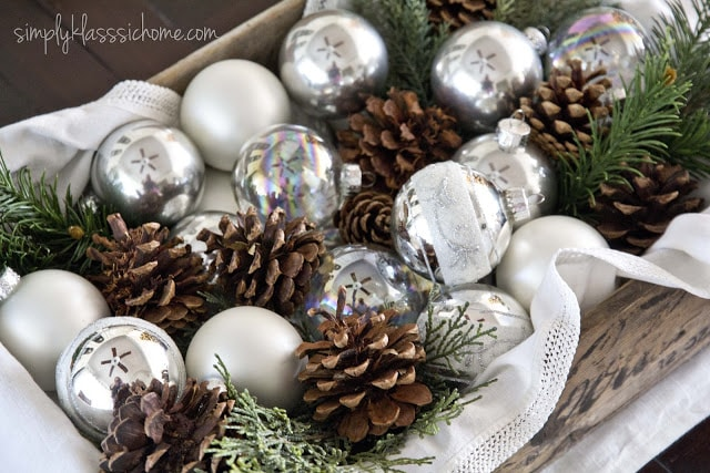 Ornaments and pinecone on table