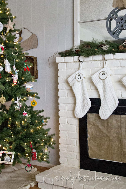 Stockings on a fireplace and Christmas tree