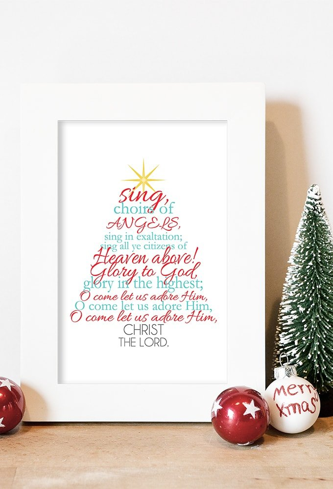 "Free Christmas printable with the Christmas carol ""O Come All Ye Faithful"" lyrics displayed in aqua and red."