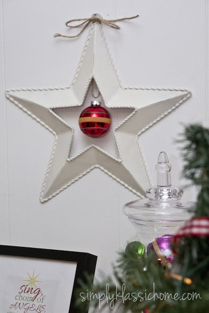 White barn star with a red ornament