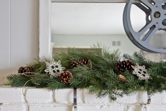 Garland with pinecones on fireplace