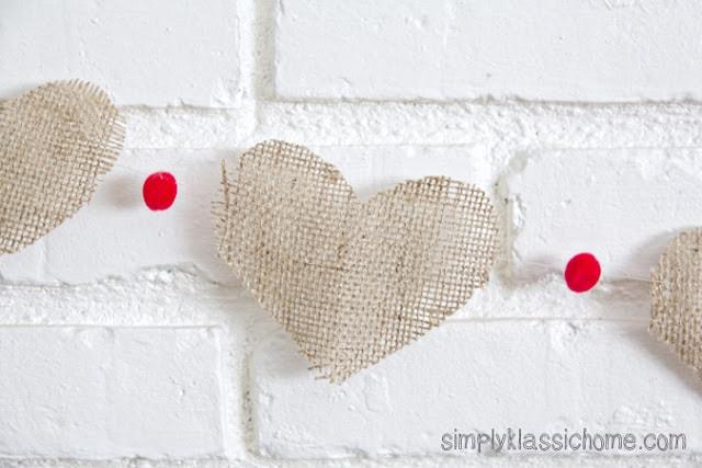 Burlap heart garland on a wall
