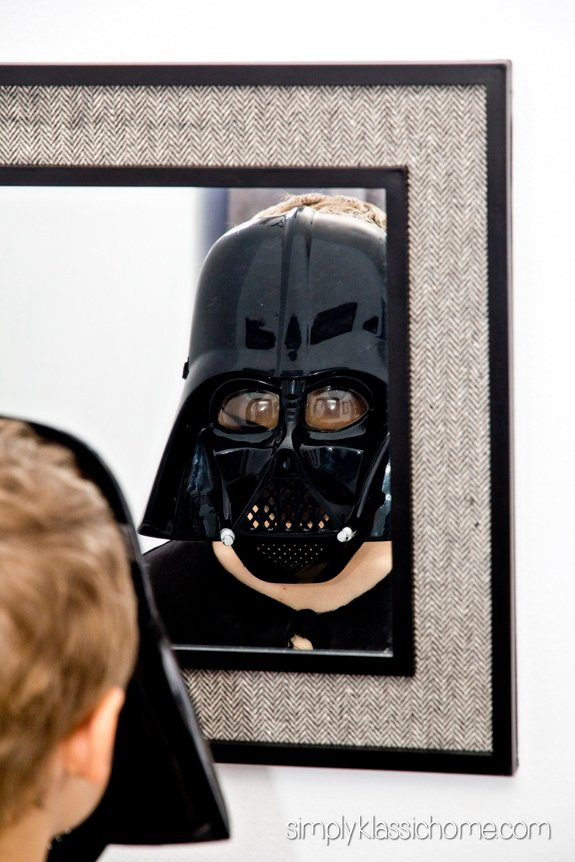 A boy with a Darth Vader mask on