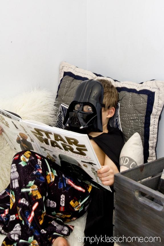 A boy reading a Star Wars book