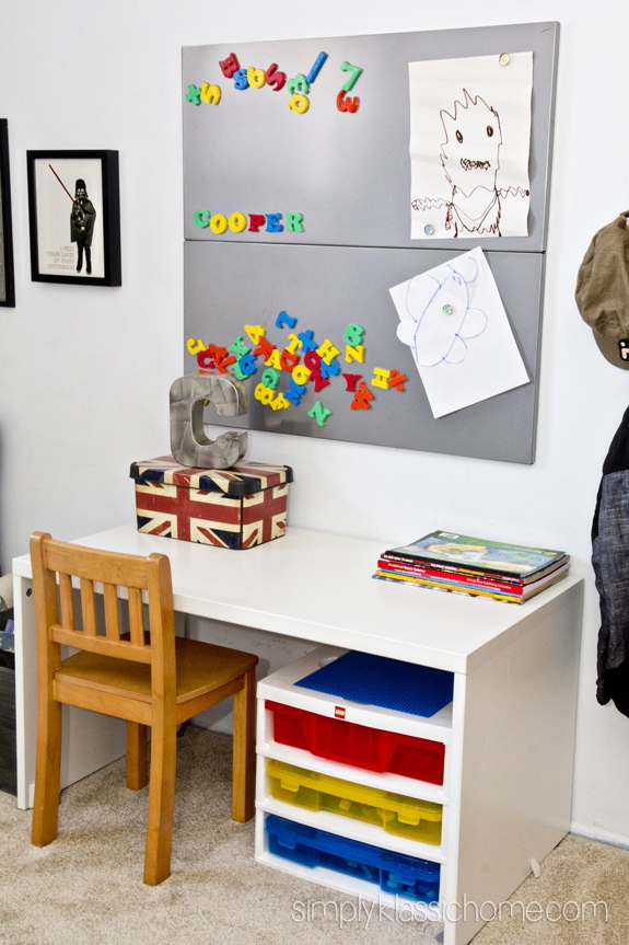 A desk and art area in a bedroom