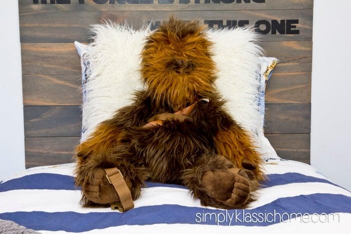 Stuffed animal lying on a bed