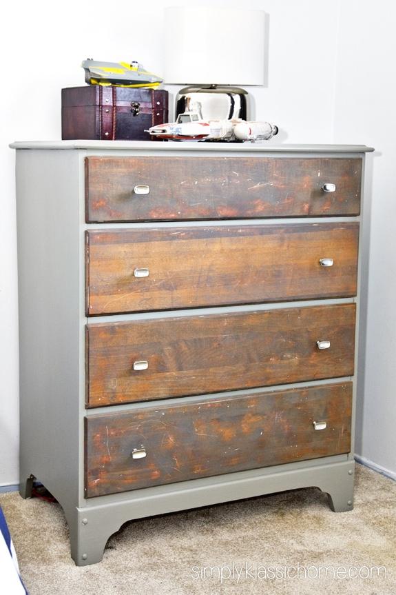 A gray wooden dresser