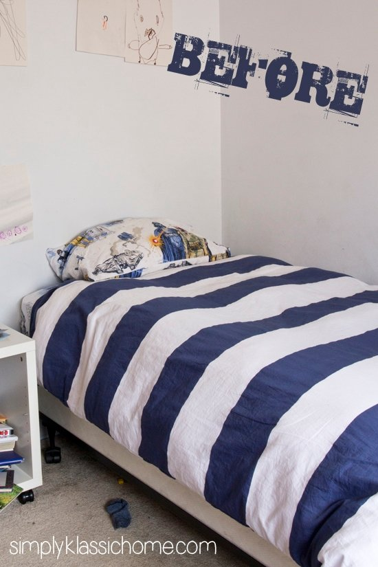 A bed with blue striped comforter