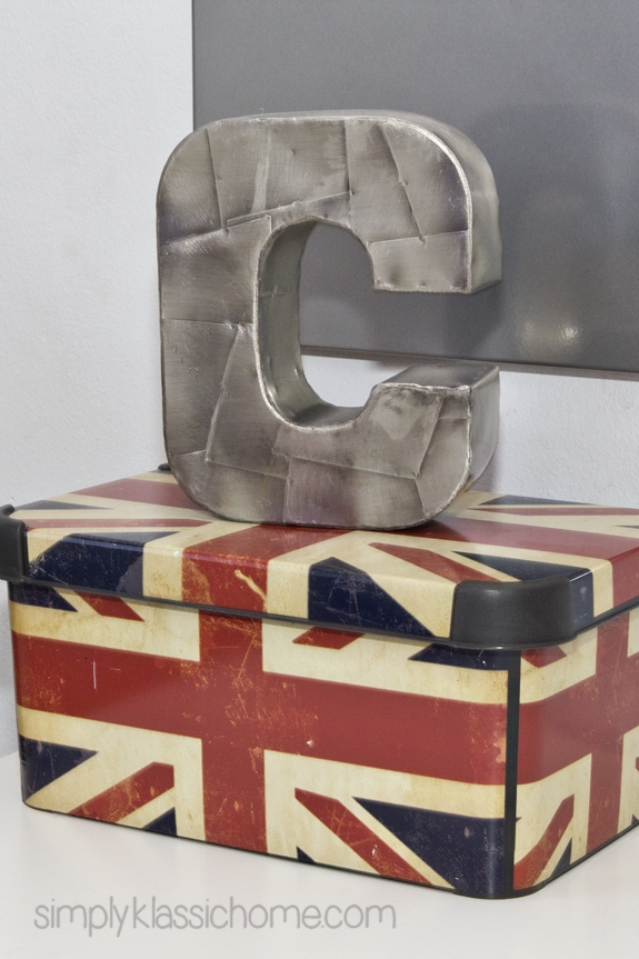 A union jack box with metal letter C