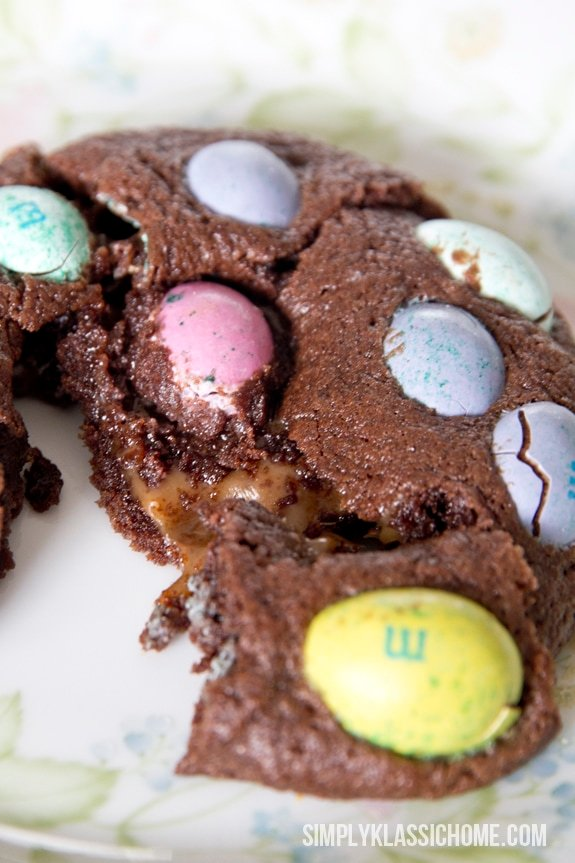 A piece of chocolate cookie with M&Ms