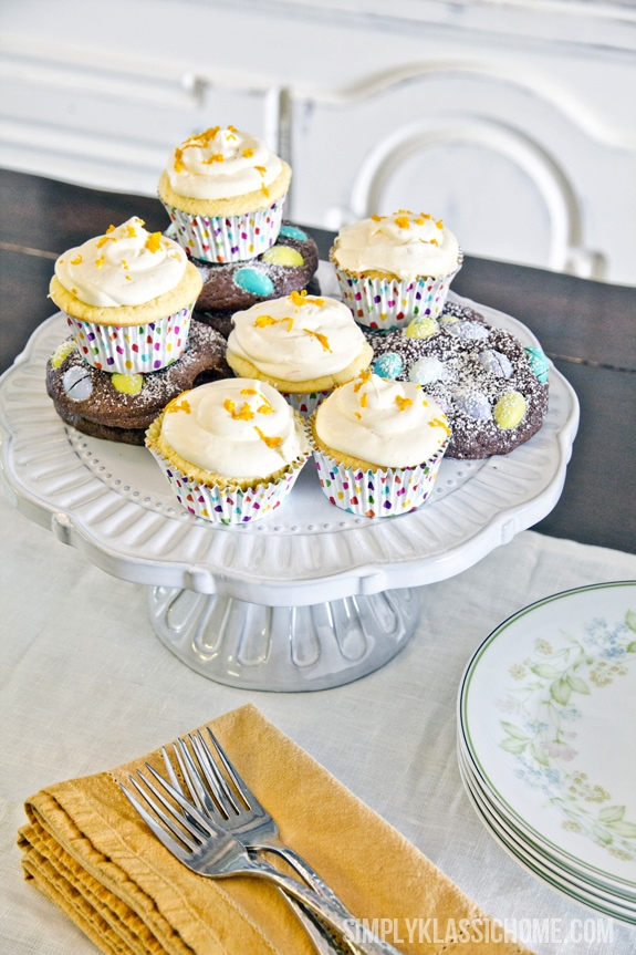 Cupcakes and cookies on a white cake stand