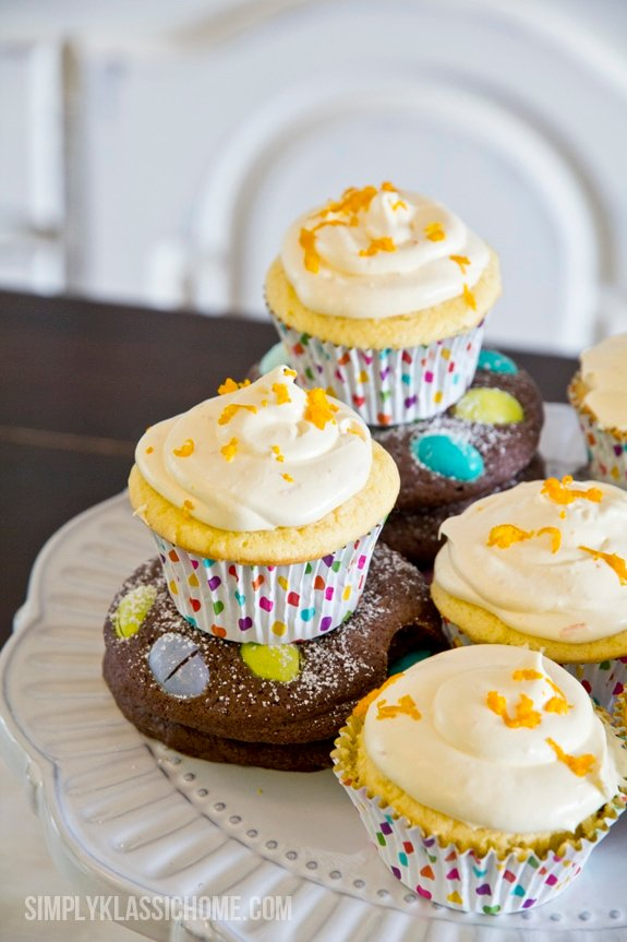 Cupcakes with yellow frosting on a plate