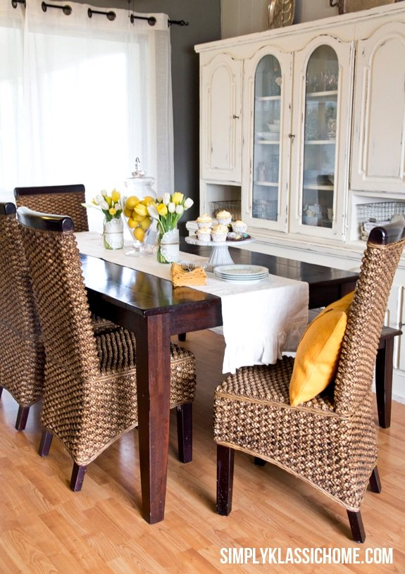 A dining room filled with furniture and a window